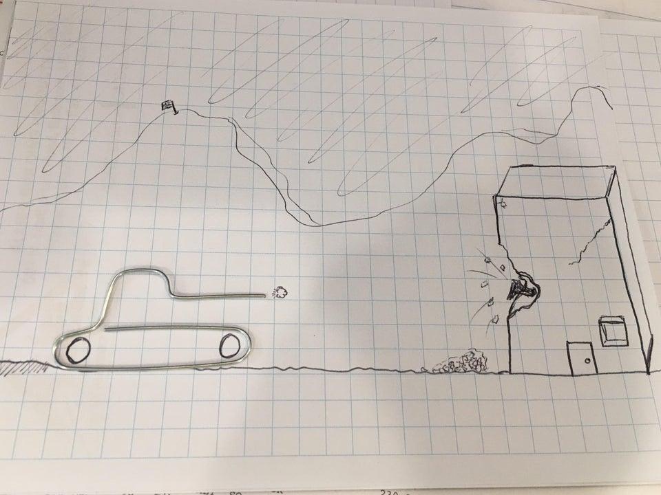 peisaj construit dintr-o agrafa de hartie modelata in forma de tanc si desenul cu creionul al unei cladiri care e bombardata pe o foaie de matematica